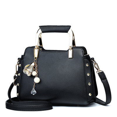 韓版休閒鉚釘金屬柄手提包