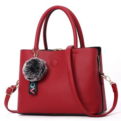 韓版純色定型簡約毛球手提包
